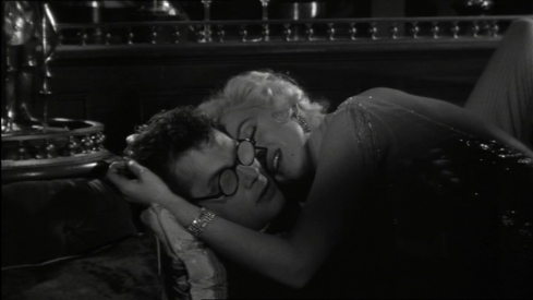 Marilyn Monroe kisses Tony Curtis in Some Like It Hot (1958)